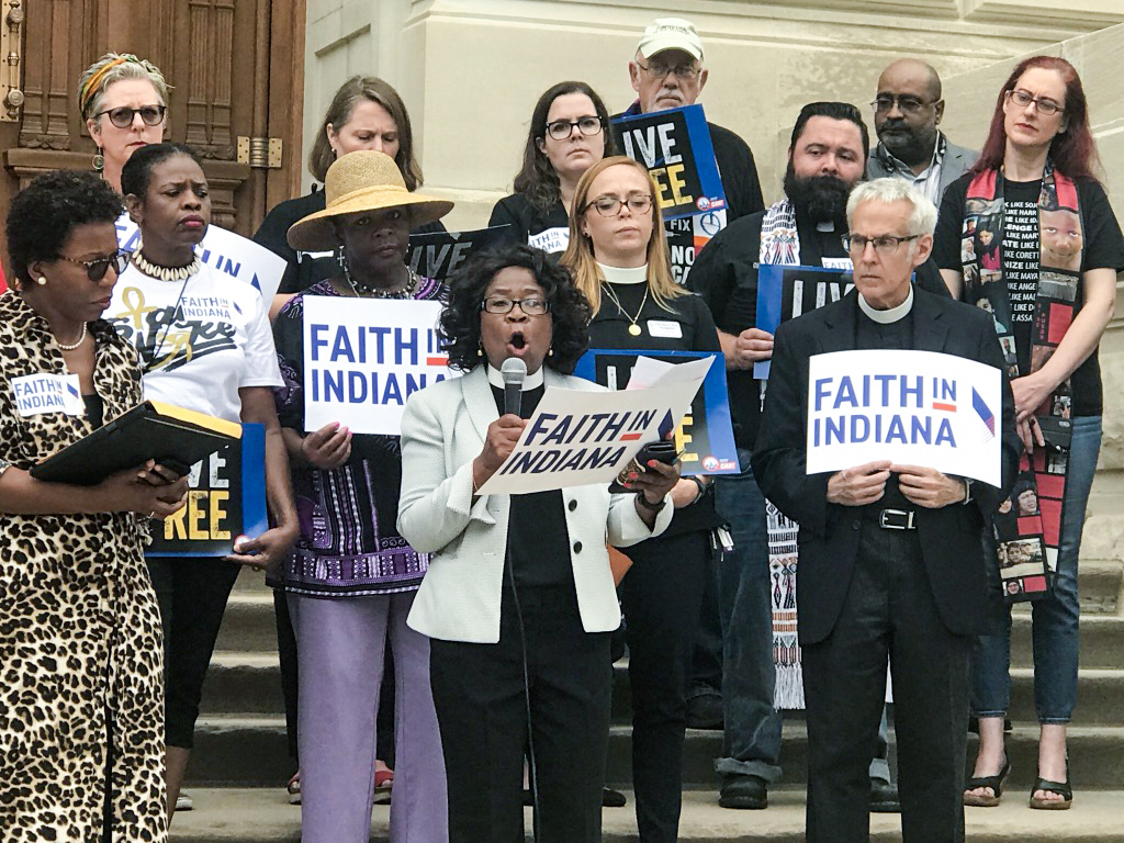 Faith in Indiana leaders speak on the steps of the Indiana State House in 2019.